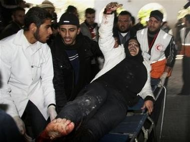 660012247-palestinian-medics-wheel-a-wounded-woman-who-according-to-palestinian.jpg