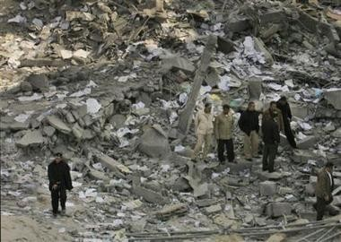 1922057754-palestinians-gather-in-the-rubble-of-a-building-used-by.jpg